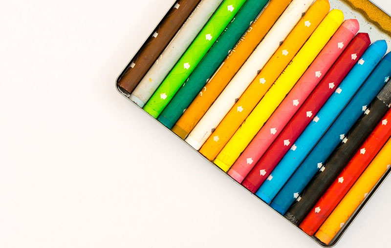 multi colored pencils over white background 286559 1 - Huisstijl